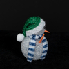 White EVA snowman with green hat
